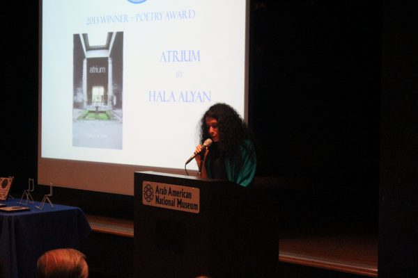 Hala Alyan accepting her award for the 2014 Arab American Book of the Year for Poetry